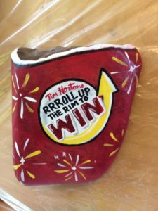 Photo of Tim Hortons Coffee cup inspired rock painting! Photo courtesy Purple Door Creative