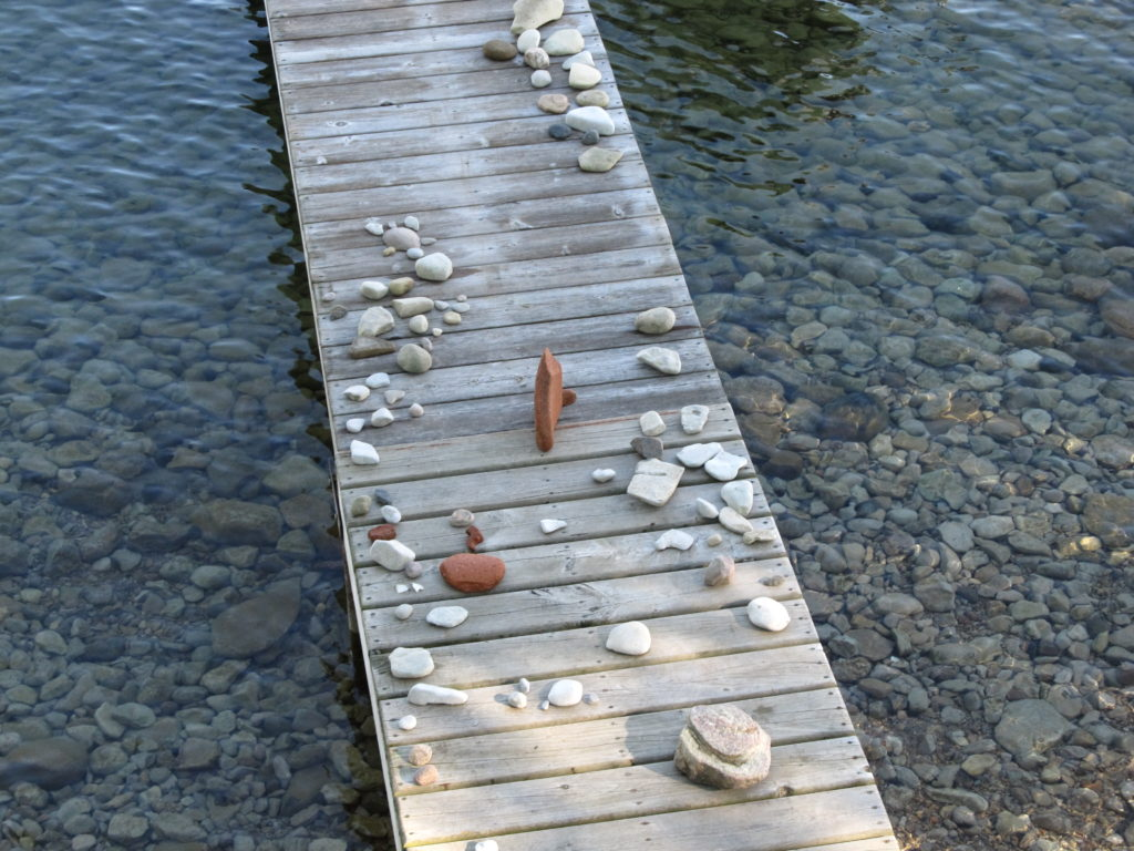 Photo of rocks drying on a dock. Photo Courtesy Purple Door Creative