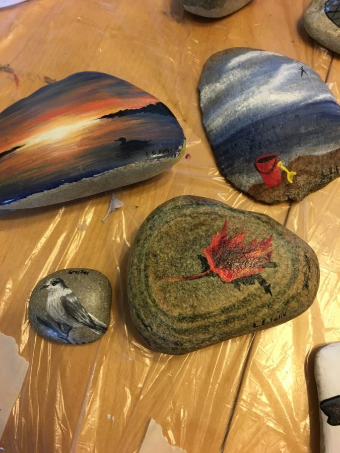 Photo of four painted rocks for Hastings Rock Canada Day event. Photo courtesy Purple Door Creative