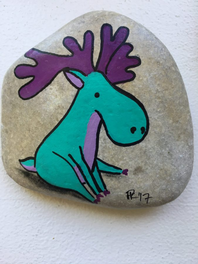 Photo of team and purple moose painted on a rock. Photo courtesy Random Acts of Creativity