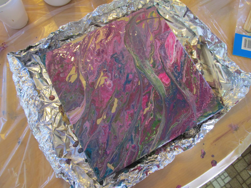 Canvas painted with dirty pour and cup flip method. Photo courtesy Purple Door Creative