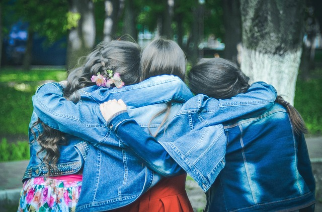 Free stock photo of three girlfriends hugging. Photo courtesy Pixabay.